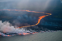 lava erupting from fissure 8 of the Kilauea Volcano east rift zone in Leilani Estates subdivision, near Pahoa, flows as a glowing river through agricultural plots to enter the ocean just south of Cape Kumukahi, Kapoho, Puna, Big Island, Hawaii, USA, Pacific Ocean