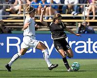 Tina DiMartino (5)  kicks the ball past Lisa Sari (left). Los Angeles Sol defeated FC Gold Pride 2-0 at Buck Shaw Stadium in Santa Clara, California on May 24, 2009.