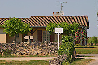 A sign in the vineyard saying Chateau Laroque Grand Cru Classe in front of a house which is probably not the chateau itself Saint Emilion Bordeaux Gironde Aquitaine France