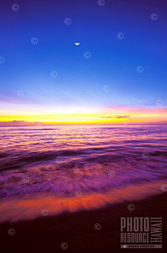 Sunset on Wailua beach with cresent moon, island of Kauai