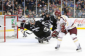 Alex Beaudry (PC - 35) makes a save on Steven Whitney (BC - 21). - The Boston College Eagles defeated the Providence College Friars 4-2 in their Hockey East semi-final on Friday, March 16, 2012, at TD Garden in Boston, Massachusetts.