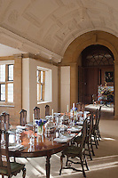 The mullioned windows that run the length of Sir Edwin Lutyens Elizabethan interpretation of a dining room bathe the table in sunlight