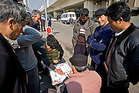 A Xiangqi game, the chinese chess, in a street of Shanghai..Shanghai, February 2006.