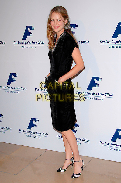 JACINDA BARRETT.The Los Angeles Free Clinic Annual Dinner Gala Honoring Paramount Pictures Corporation Chairman and CEO Brad Grey held at the Beverly Hilton Hotel in Beverly Hills, California, USA..November 20th, 2006.full length black dress hand in pocket.CAP/DVS.©Debbie VanStory/Capital Pictures