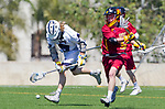 Los Angeles, CA 04/01/16 - Cole Roberson (USC #5) and unidentified LMU player(s) in action during the University of Southern California and Loyola Marymount University SLC conference game  USC defeated LMU.