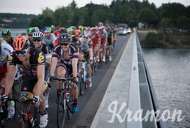 John Degenkolb (DEU/Giant-Alpecin) & Mark Cavendish (GBR/Etixx-QuickStep) sharing jokes/stories while crossing the bridge over the Lac de Pareloup<br /> <br /> stage 14: Rodez - Mende (178km)<br /> 2015 Tour de France