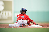 Boston Red Sox Yeison Coca (11) slides into third base during an Instructional League game against the Minnesota Twins on September 23, 2016 at JetBlue Park at Fenway South in Fort Myers, Florida.  (Mike Janes/Four Seam Images)