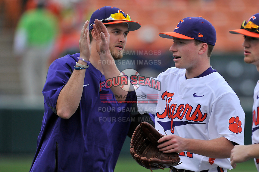 Starting pitcher Alex Schnell (47) of the Clemson University Tigers is congratulated bt Clate Schmidt during a game against the Wofford College Terriers on Tuesday, March 1, 2016, at Doug Kingsmore Stadium in Clemson, South Carolina. Clemson won, 7-0. (Tom Priddy/Four Seam Images)
