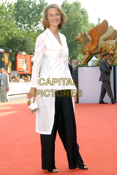 """CHARLOTTE RAMPLING.Premiere  of the film """"Vers le Sud"""" at the 62nd Venice Film Festival..September 7th, 2005.full length white blouse CLUTCH PURSE BLACK TROUSERS.www.capitalpictures.com.sales@capitalpictures.com.© Capital Pictures."""
