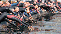 03 SEP 2006 - LAUSANNE, SWITZERLAND - Elite men dive into the water at the start of the World Elite Mens Triathlon Championships. (PHOTO (C) NIGEL FARROW)