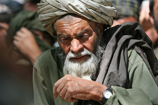 An old man waits outside the district center of Shar-e-Safa in Zabul province, Afghanistan. U.S. troops provided medical care, and Afghan police distributed winter clothes, food staples and other relief items to about 200 people before they ran out of supplies.  Aug. 25, 2008. DREW BROWN/STARS AND STRIPES