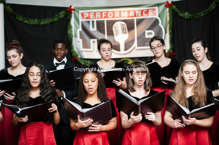 TORRINGTON, CT-5 December 2014-120514EC02-  The Torrington High School choir sings Christmas carols at the Performance HUB in downtown Torrington Friday night. The annual Toy Shower for Christmas Village raises money to give gifts for children who visit Santa at the Village. Christmas Village opens December 7th. Erin Covey Republican-American