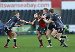 Munster centre Denis Hurley in need of support as Ospreys trio Hanno Dirksen, Ben John and Jonathan Spratt close in.<br /> Guiness Pro12<br /> Ospreys v Munster<br /> Liberty Stadium<br /> 07.03.15<br /> &copy;Steve Pope - SPORTINGWALES