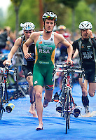 11 SEP 2010 - BUDAPEST, HUN - Hendrik de Villiers leaves transition for the start of the bike at the 2010 Elite Mens ITU World Championship Series Triathlon final (PHOTO (C) NIGEL FARROW)