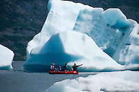 Rafters float among the icebergs while heading toward the Placer River.