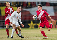 COLLEGE PARK, MD - NOVEMBER 15: Joe Schmidt #16 of Indiana moves past Eric Matzelevich #15 of Maryland during a game between Indiana University and University of Maryland at Ludwig Field on November 15, 2019 in College Park, Maryland.