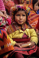 Peru, Willoq.  Little Quechua Girl Eating Bread for Lunch.
