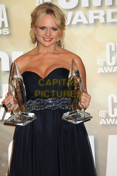 Miranda Lambert.The 46th Annual CMA Awards, Country Music's Biggest Night, held at Bridgestone Arena, Nashville, Tennessee, USA, 1st November 2012..music awards press room half length strapless black dress winner awards trophies .CAP/ADM/DMF.©Dara-Michelle Farr/AdMedia/Capital Pictures.