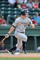 Right fielder Austin Aune (22) of the Charleston RiverDogs bats in a game against the Greenville Drive on Sunday, August 16, 2015, at Fluor Field at the West End in Greenville, South Carolina. Charleston won, 6-2. (Tom Priddy/Four Seam Images)
