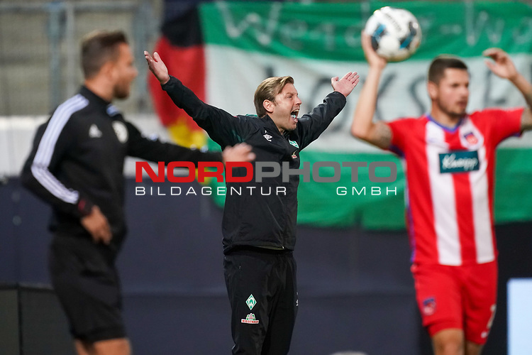 Florian Kohfeldt (Trainer SV Werder Bremen), Gestik, Mimik, wuetend emotionen<br /> <br /> <br /> Sport: nphgm001: Fussball: 1. Bundesliga: Saison 19/20: Relegation 02; 1.FC Heidenheim vs SV Werder Bremen - 06.07.2020<br /> <br /> Foto: gumzmedia/nordphoto/POOL <br /> <br /> DFL regulations prohibit any use of photographs as image sequences and/or quasi-video.<br /> EDITORIAL USE ONLY<br /> National and international News-Agencies OUT.