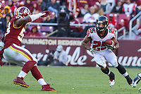 Landover, MD - November 4, 2018: Atlanta Falcons running back Ito Smith (25) runs the ball during the  game between Atlanta Falcons and Washington Redskins at FedEx Field in Landover, MD.   (Photo by Elliott Brown/Media Images International)