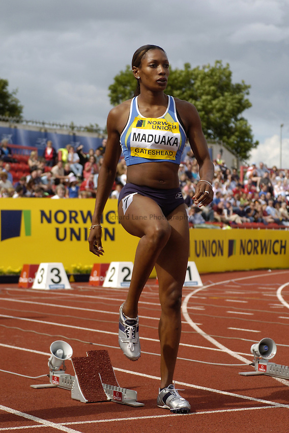 Photo. Jed Wee..Norwich Union British Grand Prix, 27/06/2004..Britain's Joice Maduaka with Norwich Union boards.