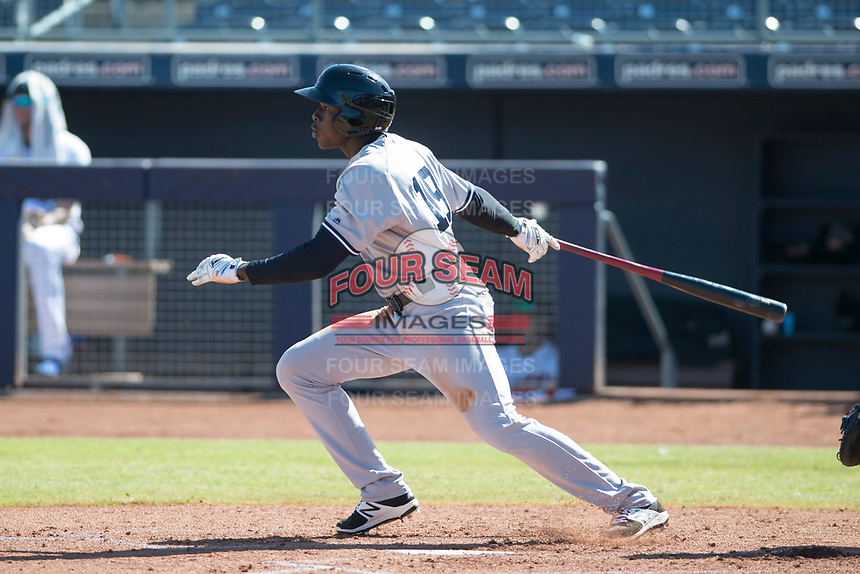 Scottsdale Scorpions right fielder Estevan Florial (19), of the New York Yankees organization, follows through on his swing during a game against the Peoria Javelinas on October 19, 2017 at Peoria Stadium in Peoria, Arizona. The Scorpions defeated the Javelinas 13-7.  (Zachary Lucy/Four Seam Images)