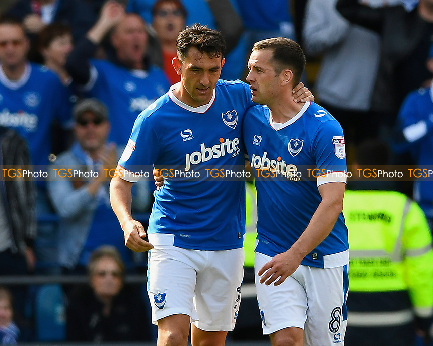 Goalscorer Gary Roberts of Portsmouth left is congratulated by skipper Michael Doyle during Portsmouth vs Plymouth Argyle, Sky Bet EFL League 2 Football at Fratton Park on 14th April 2017