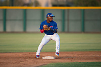 AZL Cubs 1 second baseman Yonathan Perlaza (12) attempts to turn a double play during an Arizona League game against the AZL Padres 1 at Sloan Park on July 5, 2018 in Mesa, Arizona. The AZL Cubs 1 defeated the AZL Padres 1 3-1. (Zachary Lucy/Four Seam Images)