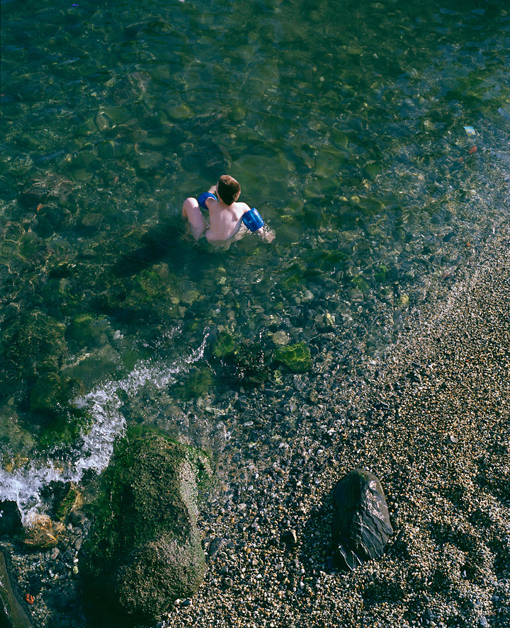 Boy swimming in Liguria, Italy