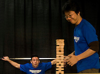 Photo by Stephen Brashear.Noah Callaway, left, of Seattle watches as Thomas Chan of Chicago makes it to his next turn in Jenga during the fifth round of the Omegathon during the final day Penny Arcade Exposition at the Washington State Visitor and Convention Center in Seattle, Wash., Sunday Aug. 31, 2008.