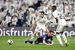 Real Madrid CF's Sergio Reguilon, Vinicius Junior and FC Barcelona's Sergio Busquets during La Liga match. March 02,2019. (ALTERPHOTOS/Alconada)