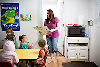 Lora Reyes is a licensed family childcare educator in Westfield, Mass., where she operates the daycare Lora's Little Ones out of her home on Thurs., June 2, 2016. Here she prepares a french toast breakfast for the children. Today she was in charge of 7 children, aged 14 months to 5 years old, handling meals, playtime, and educational activities throughout the day, starting about 7am and going until 4:30pm. She uses the Mother Goose Time curriculum throughout the day. Reyes is currently pursuing an undergraduate degree in Psychology at Holyoke Community College. She started 2 years ago after earning a Child Development Associate certification.