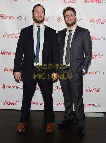 LAS VEGAS, NV - March 27: Comedy Filmmakers of the Year Award winners Evan Goldberg and Seth Rogan at the CinemaCon Big Screen Achievement Awards on March 27, 2014 in Las Vegas, Nevada.<br /> CAP/MPI/RTNKAB<br /> &copy;RTNKAB/MPI/Capital Pictures