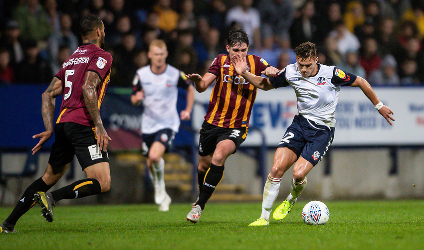 Bolton Wanderers' Dennis Politic (right) competing with Bradford City's Jackson Longridge <br /> <br /> Photographer Andrew Kearns/CameraSport<br /> <br /> EFL Leasing.com Trophy - Northern Section - Group F - Bolton Wanderers v Bradford City -  Tuesday 3rd September 2019 - University of Bolton Stadium - Bolton<br />  <br /> World Copyright © 2018 CameraSport. All rights reserved. 43 Linden Ave. Countesthorpe. Leicester. England. LE8 5PG - Tel: +44 (0) 116 277 4147 - admin@camerasport.com - www.camerasport.com