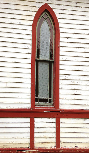 A decorative churth window shows an alternative to stained glass, Billie Creek Villade Historic site, Rockville, Indiana