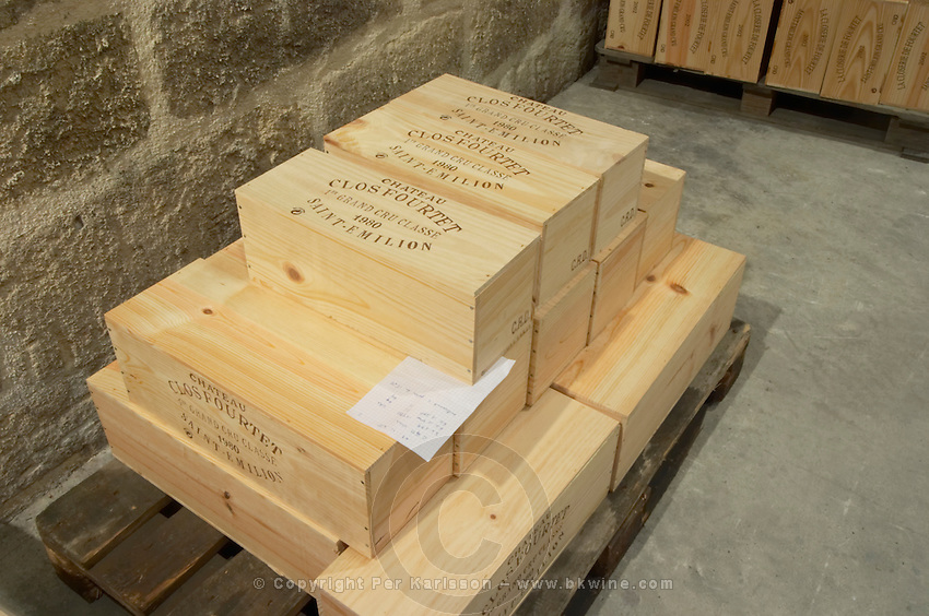 Bottles aging in the cellar. In cases. Chateau Clos Fourtet, Saint Emilion, Bordeaux, France