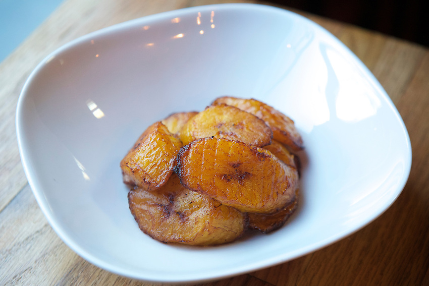 BROOKLYN, NY - Fried yellow plantains at Angela's, a small West Indian restaurant on Nostrand Avenue in Bedford-Stuyvesant.<br /> <br /> CREDIT: Clay Williams for the James Beard Foundation.<br /> <br /> &copy; Clay Williams / claywilliamsphoto.com