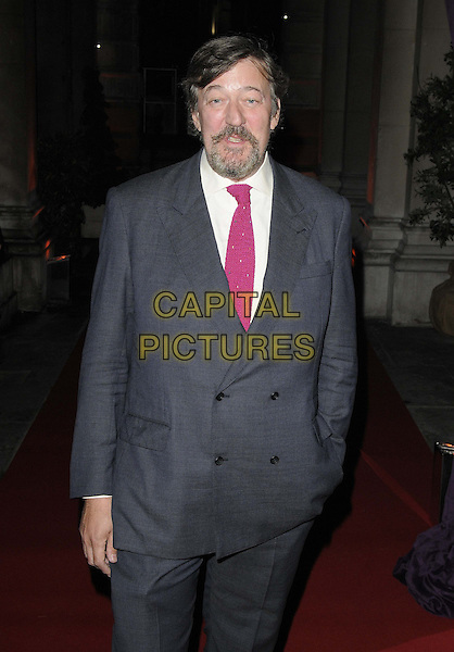 Stephen Fry.The 'RA Now' VIP gala, Royal Academy of Arts, Burlington House, Piccadilly, London, England..October 8th, 2012.half length blue suit jacket white shirt tie pink goatee facial hair.CAP/CAN.©Can Nguyen/Capital Pictures.