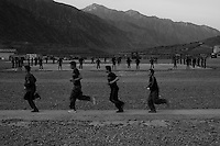 Afghan National Army soldiers exercise  on the flight line of Forward Operating Base Bostick in Northern Kunar Province, Afghanistan at dawn on Sunday March 28 2010...Afghan soldiers are from 1st Coi ( Company ), 1st Kandak ( battalion ) 2nd Brigade.