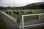Visiting players warming up  before Gala Fairydean Rovers host Gretna 2008 in a Scottish Lowland League match at Netherdale, Galashiels. The home club were established in 2013 through a merger of Gala Fairydean, one of Scotland's most successful non-League clubs, and local amateur club Gala Rovers. The visitors were a 'phoenix' club set up in the wake of the collapse of the original club, which had competed for a short time in the 2000s before going bankrupt. The home aside won this encounter 4-1 watched by a crowd of 120 at a stadium which features one of the country's most notable stands, a listed building constructed in 1964 but at the time of this fixture closed to spectators on safety grounds.