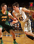 BROOKINGS, SD - JANUARY 25:  Jordan Dykstra #42 from South Dakota State University drives against Chris Kading #34 from North Dakota State University in the first half of their game Saturday afternoon at Frost Arena in Brookings. (Photo by Dave Eggen/Inertia)