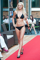Marianna Mihaly a participant of the Beauty Queen contest attends a bikini tour in Hotel Abacus, Herceghalom, Hungary on July 07, 2011. ATTILA VOLGYI