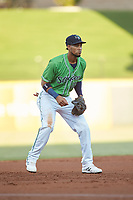 Gwinnett Stripers third baseman Pedro Florimon (18) on defense against the Scranton/Wilkes-Barre RailRiders at BB&T BallPark on August 16, 2019 in Lawrenceville, Georgia. The Stripers defeated the RailRiders 5-2. (Brian Westerholt/Four Seam Images)