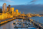 Seattle, WA   <br /> Seattle waterfront at the Bell Street Harbor Marina and city skyline, dusk