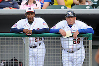 Tennessee Smokies hitting coach Mariano Duncan #25 and manager Buddy Bailey #26 watch their team during a game against the Jackson Generals at Smokies Park, Kodak, Tennessee April 13, 2012. The Smokies won 4-1  (Tony Farlow/Four Seam Images)..