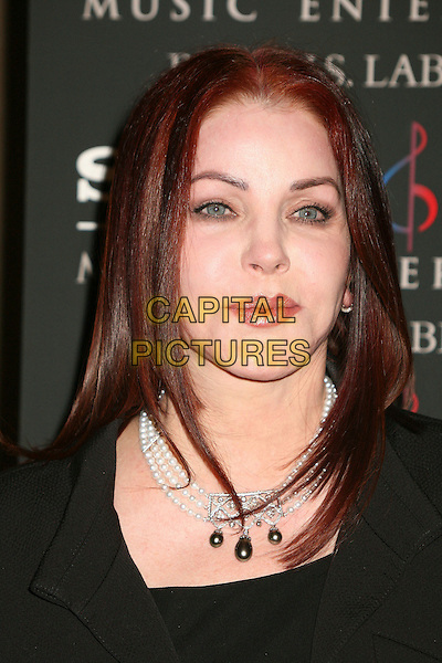 PRISCILLA PRESLEY.Clive Davis 2007 Pre-Grammy Awards Party at the Beverly Hilton Hotel, Beverly Hills, USA..February 10th, 2007.portrait headshot pearl necklace.CAP/ADM/BP.©Byron Purvis/AdMedia/Capital Pictures