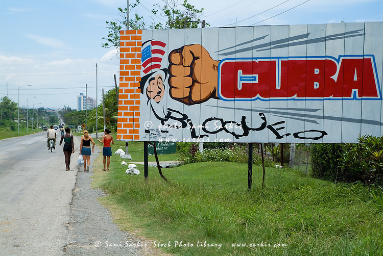 Political poster on a billboard showing Cuban resistance to the American embargo nearby Cienfuegos, Cuba.