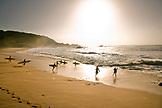USA, Hawaii, surfers running into the water, Waimea Bay, Oahu