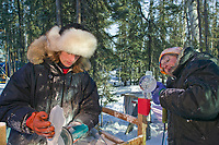 Joan Brice and Heather Brice work on the piece titled Friend or Foe, by Steve Brice, Joan Brice, Heather Brown, Tajana Raukar 1st place Multi Block, 2003 World Ice Art Championships, Fairbanks Alaska. Multi Block.